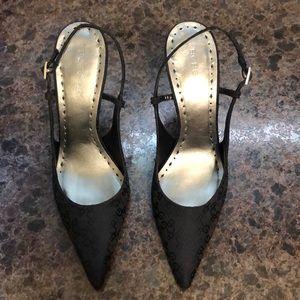 Sling back high heel shoes